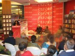 Sukreta at the lectern speaking at Oxford Bookshop New Delhi book launch